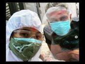कोरोना पॅाजिटिव मिलिंद सोमन ने वाइफ के साथ PPE किट में खेली होली, सामने आयी तस्वीर