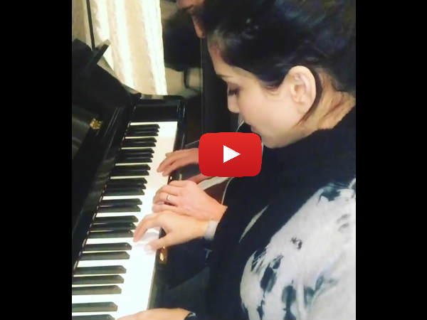 sunny-leone-daniel-weber-get-their-first-piano-lessons