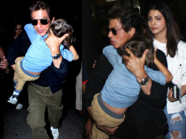 shahrukh-khan-carries-sleepy-abram-on-airport