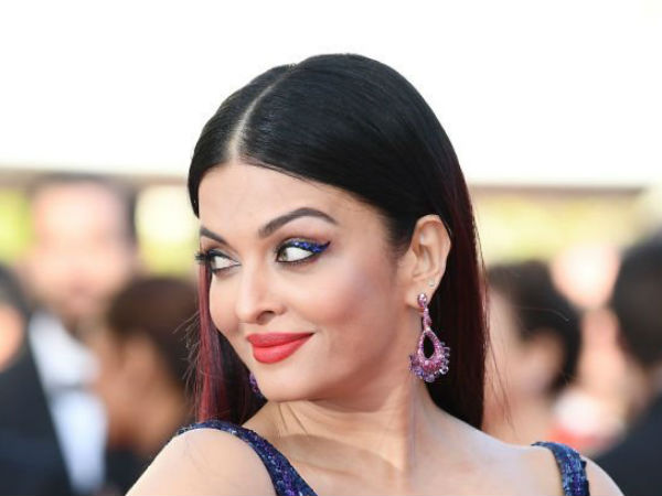 Two people hold Aishwarya's gown during Cannes Film Festival, pictures went viral on social media