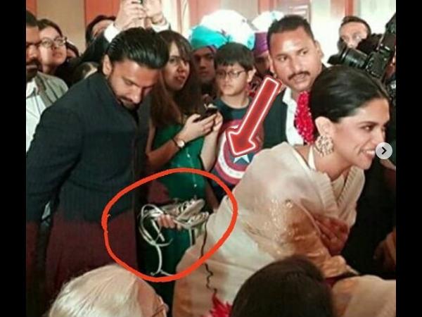 शादी समारोह में पहुंचे रणवीर सिंह ने उठाईं दीपिका पादुकोण की सैंडल्स- फोटो हो गई वायरल