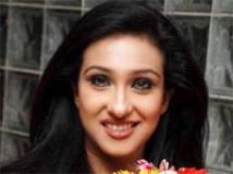 https://hindi.filmibeat.com/img/2009/03/14-rituparna-sengupta200.jpg