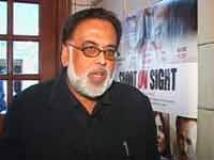 http://hindi.filmibeat.com/img/2009/08/05-jagmohan-mundhra200.jpg