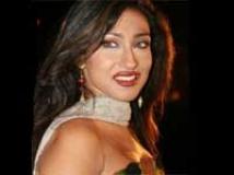 https://hindi.filmibeat.com/img/2010/04/12-rituparna-sengupta200.jpg