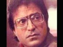 https://hindi.filmibeat.com/img/2010/07/28-ravi-baswani200.jpg