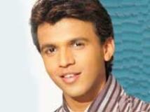 http://hindi.filmibeat.com/img/2010/12/01-abhijeet-sawant200.jpg