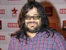 http://hindi.filmibeat.com/img/2011/01/31-preetam-musician-200.jpg