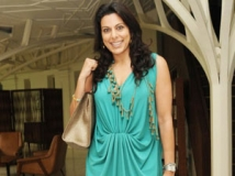 http://hindi.filmibeat.com/img/2011/10/21-pooja-bedi-300.jpg