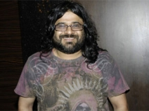 http://hindi.filmibeat.com/img/2012/06/15-pritam-chakraborty-300.jpg
