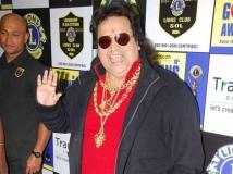 http://hindi.filmibeat.com/img/2014/04/08-31-bappi-lahiri-600.jpg