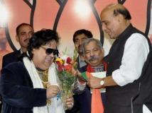 http://hindi.filmibeat.com/img/2014/04/09-21-bappi-lahiri.jpg
