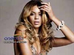 Victoria Beckham Dresses Up Beyonce
