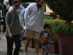 Taimur Ali Khan Takes Stroll With Saif Kareena And His Guitar