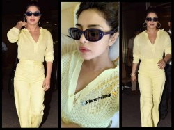Priyanka Chopra Returns To India In A Sexy Sheer Yellow Outfit View Pics
